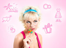Girl with lollypop. Portrait of sexy girl holding lollypop by her mouth and looking at camera outside Royalty Free Stock Image