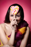 Girl with a lollypop Royalty Free Stock Image