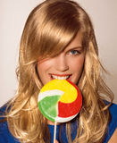 Girl with lollypop Stock Image