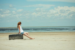 Girl on a lone beach Royalty Free Stock Image