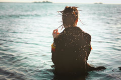 Girl lonely in the sea Stock Image