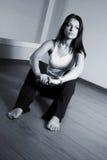 A girl with long black hair sitting on the floor Stock Photos