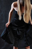 A girl with long blond beautiful hair. Look down royalty free stock image