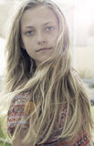 Girl with long blond hair. Portrait of attractive young girl with long blond hair outdoors Stock Images