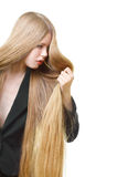 Girl with long blond hair. Portrait of beautiful girl with long unruly blond hair Stock Photo