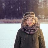 A girl with long blond hair enjoying winter active vacation. royalty free stock photography