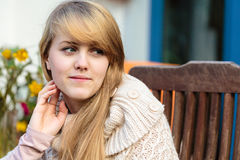Girl with long blond hair outdoors royalty free stock photo