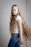 Girl with long blonde hair Stock Image