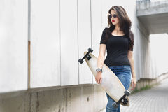 Girl with long boards Royalty Free Stock Photography