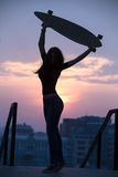 Girl with long boards Stock Images