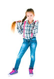 Girl with long braid in a plaid shirt and jeans Stock Photos