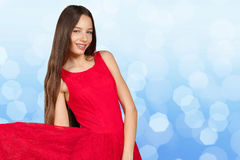 Girl with long brown hair in red dress Stock Image