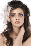 Girl with long curled hairstyle and feather royalty free stock image