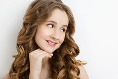 Girl with long curly hair royalty free stock image