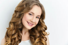 Girl with long curly hair stock images