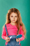 Girl with long curly hair and hairbrush Royalty Free Stock Images