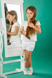 Girl with long curly hair and hairbrush Stock Photos