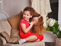 Girl with long curly hair Royalty Free Stock Images