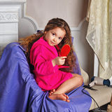 Girl with long curly hair Royalty Free Stock Photos