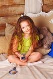 Girl with long curly hair Stock Photos