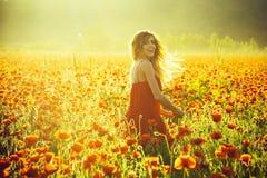 Girl in field of poppy seed stock photo