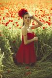 Girl in field of poppy seed royalty free stock photography