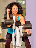 Girl with long curly hair workout on bicep curl Stock Photography