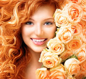 Girl with long curly red hair stock photo