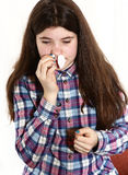 Girl with long dark brown hair has nasal bleeding Stock Photography
