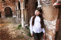 Girl with long dark hair  in ancient city ruin Royalty Free Stock Photography
