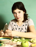 Girl  long dark hairs prepare pies with cut apples Stock Photography
