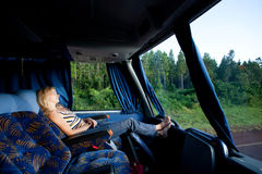 Girl in a long-distance bus Royalty Free Stock Photos