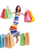 A girl in a long dress color with shopping bags Stock Photo