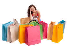 A girl in a long dress color with shopping bags Stock Images