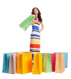A girl in a long dress color with shopping bags Stock Photography
