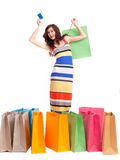 A girl in a long dress color with shopping bags Royalty Free Stock Photo