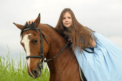 Girl  with a horse Stock Photos