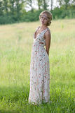 Girl in a a long dress on nature Royalty Free Stock Image