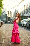 Girl in long dress on street of old town Royalty Free Stock Photo