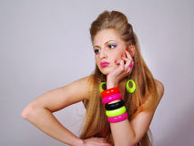 Girl with a long fair hair with colorful make up Stock Photos