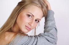 Girl with a long fair hair with a natural make-up Stock Photography