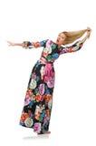 Girl in long flower dress isolated on white Stock Photos