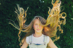Girl with long fly blond hair Stock Photos
