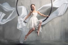 Girl with long flying dress Stock Images