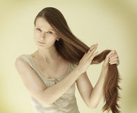 The girl with long hair Stock Image