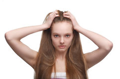Girl with long hair. Sad young girl with long hair on white background Stock Images