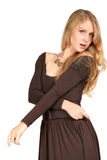 The girl with long hair. The blonde with long hair in a brown dress Royalty Free Stock Photos