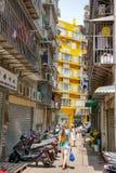Girl with long hair from back walk Macau narrow street royalty free stock image