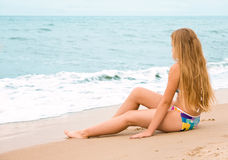Girl with long hair on the beach Royalty Free Stock Image