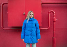 Girl with long hair in a blue jacket Royalty Free Stock Image